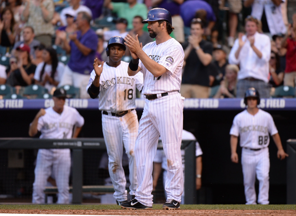 . DENVER, CO. - July 03: Todd Helton of Colorado Rockies (17) celebrate DJ LeMahieu\'s (9) 2 RBI in the 2nd inning of the game against Los Angeles Dodgers at Coors Field. Denver, Colorado. July 3, 2013. (Photo By Hyoung Chang/The Denver Post)