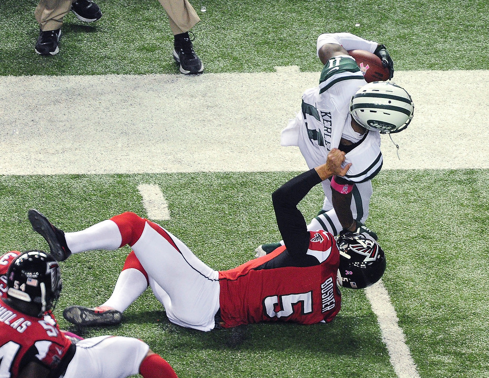 . eremy Kerley #11 of the New York Jets is tackled by a horse collar by Matt Bosher #5 of the Atlanta Falcons at the Georgia Dome on October 7, 2013 in Atlanta, Georgia. (Photo by Scott Cunningham/Getty Images)