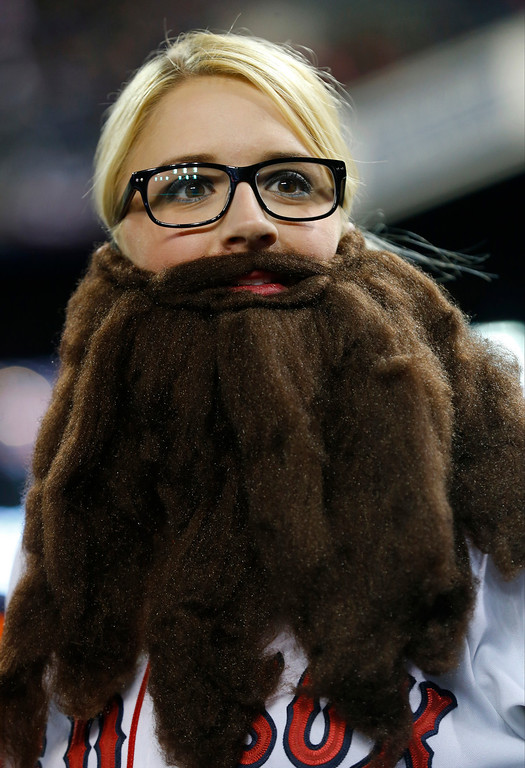 . Boston Red Sox fan Shaylan Spurway sports a fake beard before Game 5 of the American League baseball championship series against the Detroit Tigers, Thursday, Oct. 17, 2013, in Detroit. (AP Photo/Paul Sancya)