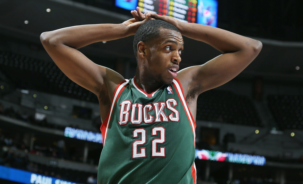 . Milwaukee Bucks forward Khris Middleton reacts as the Bucks fall behind the Denver Nuggets in the third quarter of the Nuggets\' 110-100 victory in an NBA basketball game in Denver on Wednesday, Feb. 5, 2014. (AP Photo/David Zalubowski)