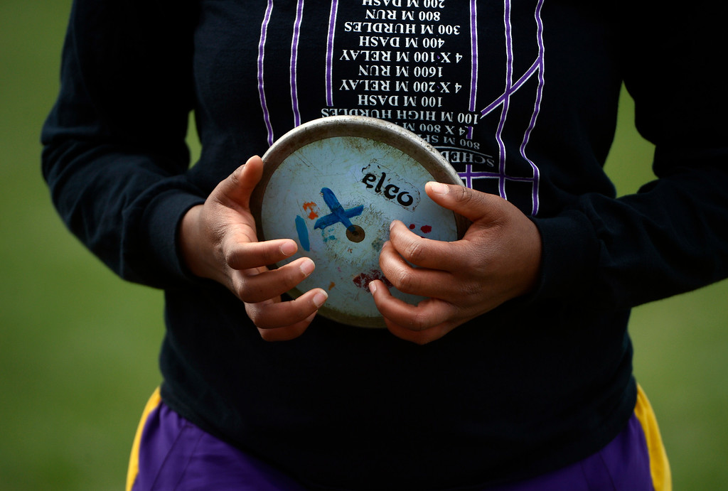 . DENVER, CO. - APRIL 13TH: Elsie Mangum, Littleton High School, during the girls discus throw competition at the Mullen Runners Roost 2013 Track and Field Invitational at Mullen High School, Saturday April, 13th 2013.(Photo By Andy Cross/The Denver Post)
