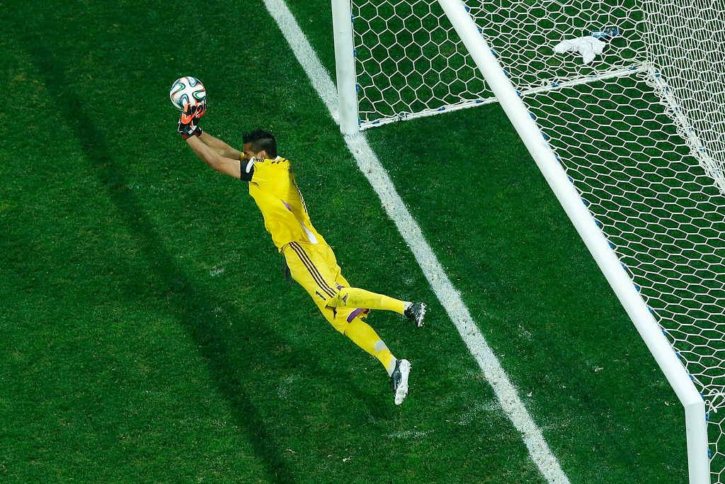 . Argentina\'s goalkeeper Sergio Romero makes a save against Netherlands\' midfielder Wesley Sneijder during penalty shoot-outs following extra time during the semi-final football match between Netherlands and Argentina of the FIFA World Cup at The Corinthians Arena in Sao Paulo on July 9, 2014.    FABRIZIO BENSCH/AFP/Getty Images