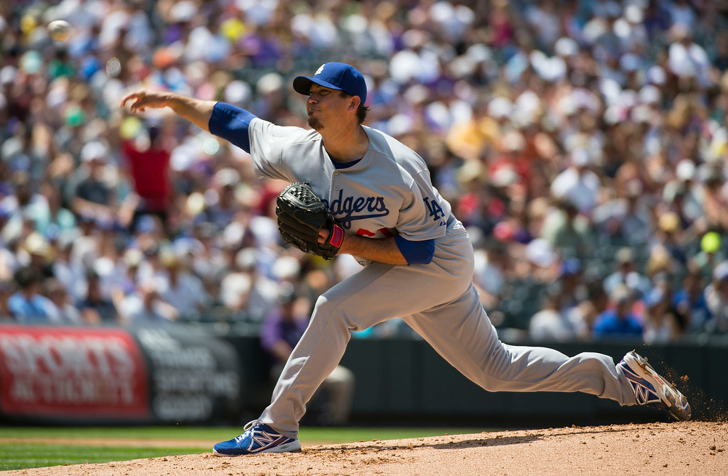. Los Angeles Dodgers starting pitcher Josh Beckett (61) delivers a pitch against the Colorado Rockies during the third inning July 6, 2014 at Coors Field. (Photo by John Leyba/The Denver Post)