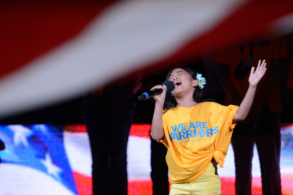 . Nayah Damasen belts out the national anthem before the start of the Denver Nuggets Golden State Warriors game in Game 6 of the first round NBA Playoffs May 2, 2013 at Oracle Arena. (Photo By John Leyba/The Denver Post)