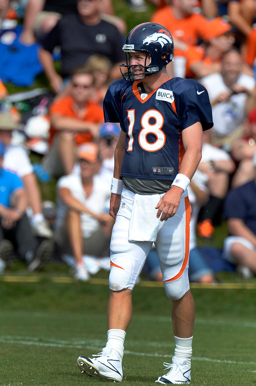 . Denver Broncos QB Peyton Manning (18) runs drills during training camp August 1, 2013 at Dove Valley. (Photo By John Leyba/The Denver Post)