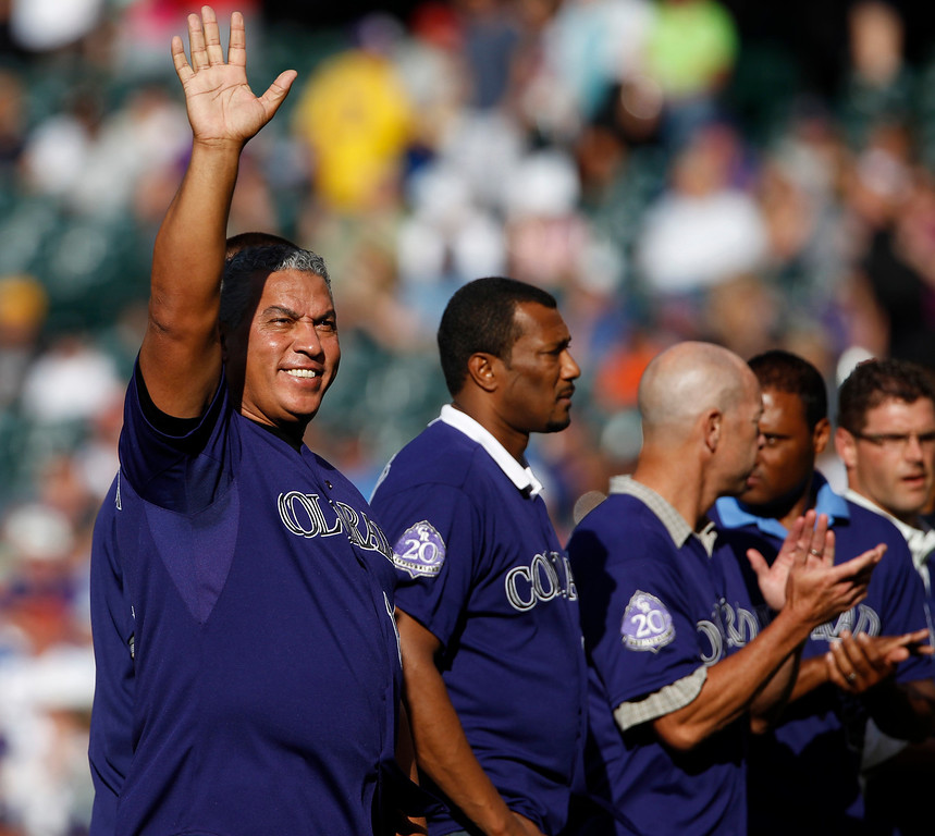 . Retired Colorado Rockies first baseman Andres Galarraga waves to the crowd along with other Rockies retirees during a ceremony to honor former Rockies before Colorado hosts the Chicago Cubs in the first inning of a baseball game in Denver on Saturday, July 20, 2013, in Denver. (AP Photo/David Zalubowski)