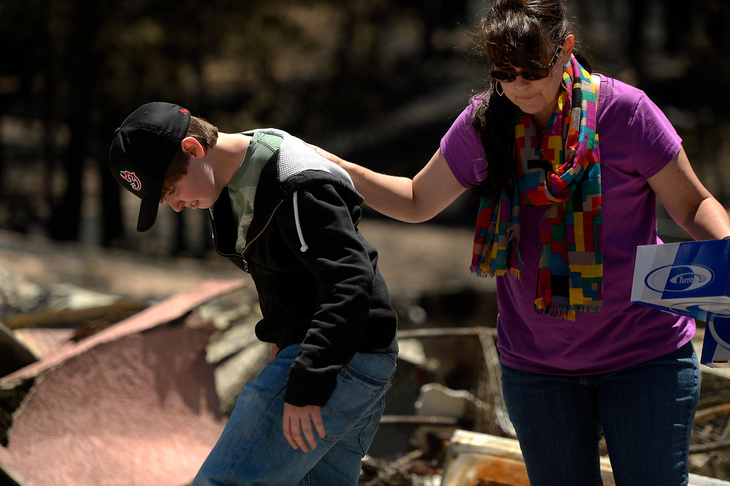 . COLORADO SPRINGS, CO. - June 19: Nolan Schultz 16 is comforted by his mother Camla during their visit to their home of 8 years. Nolan had not seen the damage and was very affected by the loss. More residents were allowed back to see their homes that were burned in the Black Forest Fire area near Colorado Springs, Colorado. June 19, 2013 Colorado Springs. (Photo By Joe Amon/The Denver Post)