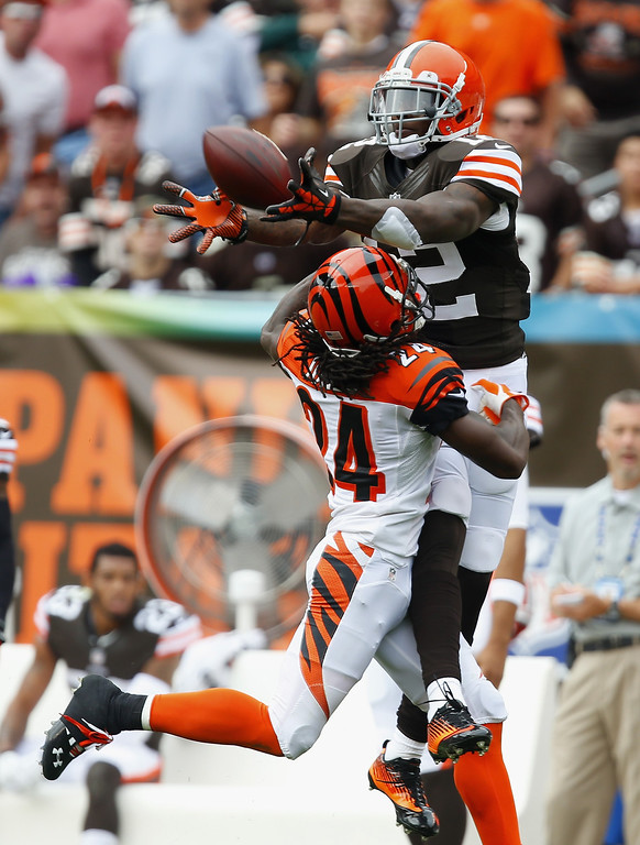 . CLEVELAND, OH - SEPTEMBER 29:  Wide receiver Josh Gordon #12 of the Cleveland Browns makes catch over cornerback Adam Jones #24 of the Cincinnati Bengals at FirstEnergy Stadium on September 29, 2013 in Cleveland, Ohio.  (Photo by Matt Sullivan/Getty Images)