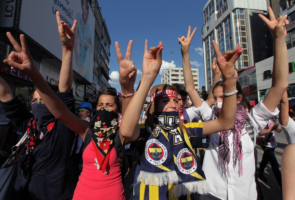 . Turkish youths shout anti-government slogans as they march in Ankara, Turkey, Tuesday, June 4, 2013.  (AP Photo/Burhan Ozbilici)