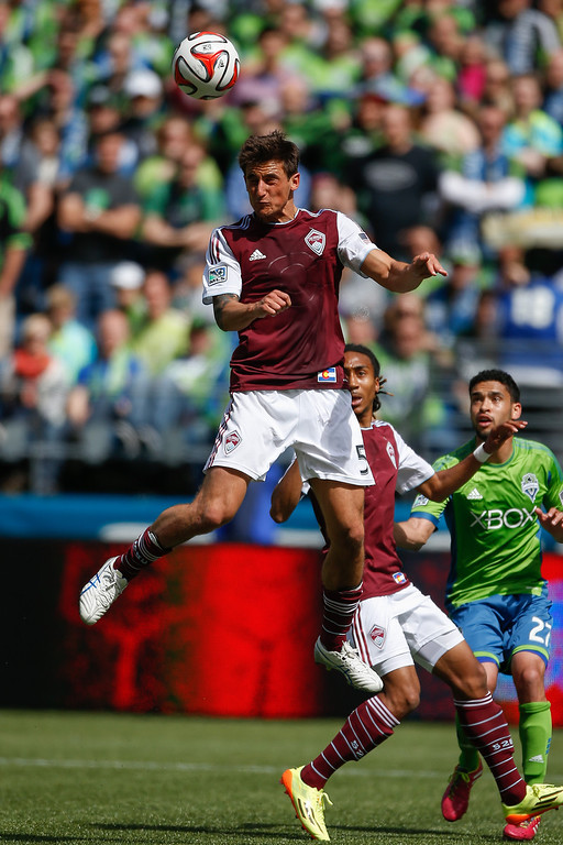 . Thomas Piermayr #5 of the Colorado Rapids heads the ball against the Seattle Sounders FC at CenturyLink Field on April 26, 2014 in Seattle, Washington. The Sounders defeated the Rapids 4-1.  (Photo by Otto Greule Jr/Getty Images)