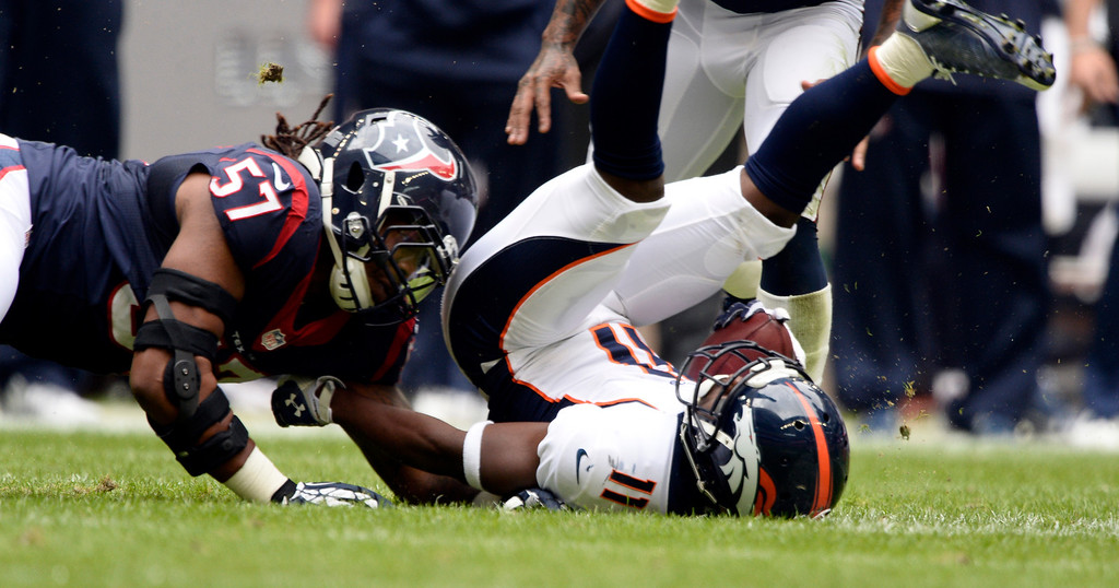 . HOUSTON, TX - DECEMBER 22: Houston Texans outside linebacker Justin Tuggle (57) puts a big hit on Denver Broncos wide receiver Trindon Holliday (11) during a punt return in the first quarter December 22, 2013 at Reliant Stadium. (Photo by John Leyba/The Denver Post)