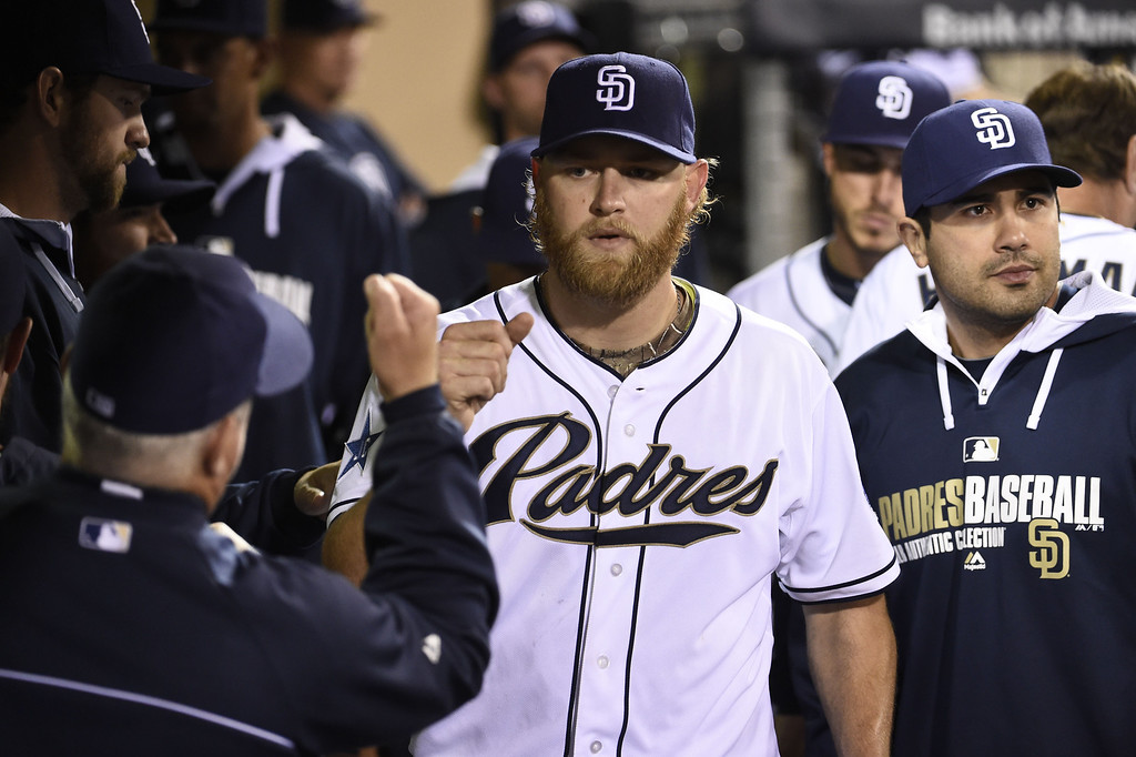 . SAN DIEGO, CA - APRIL 16:  Andrew Cashner #34 of the San Diego Padres is congratulated after leaving the game in eighth inning of a baseball game against the Colorado Rockies at Petco Park April 16, 2014 in San Diego, California.  The Padres won 4-2. (Photo by Denis Poroy/Getty Images)