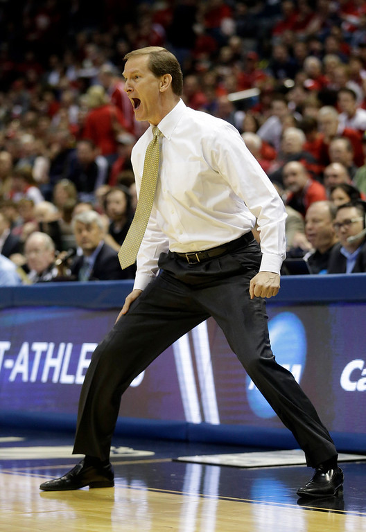 . Oregon head coach Dana Altman directs his team during the first half of a second-round game BYU in the NCAA college basketball tournament Thursday, March 20, 2014, in Milwaukee. (AP Photo/Morry Gash)