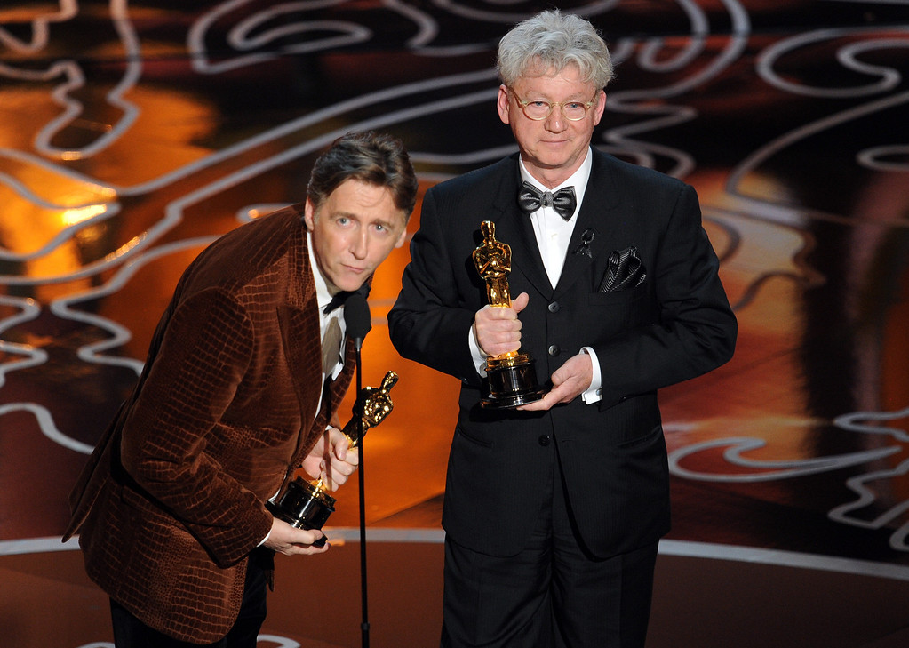 . Filmmakers Nicholas Reed (L) and Malcolm Clarke accept the Best Documentary, Short Subject award for \'The Lady In Number 6\' onstage during the Oscars at the Dolby Theatre on March 2, 2014 in Hollywood, California.  (Photo by Kevin Winter/Getty Images)
