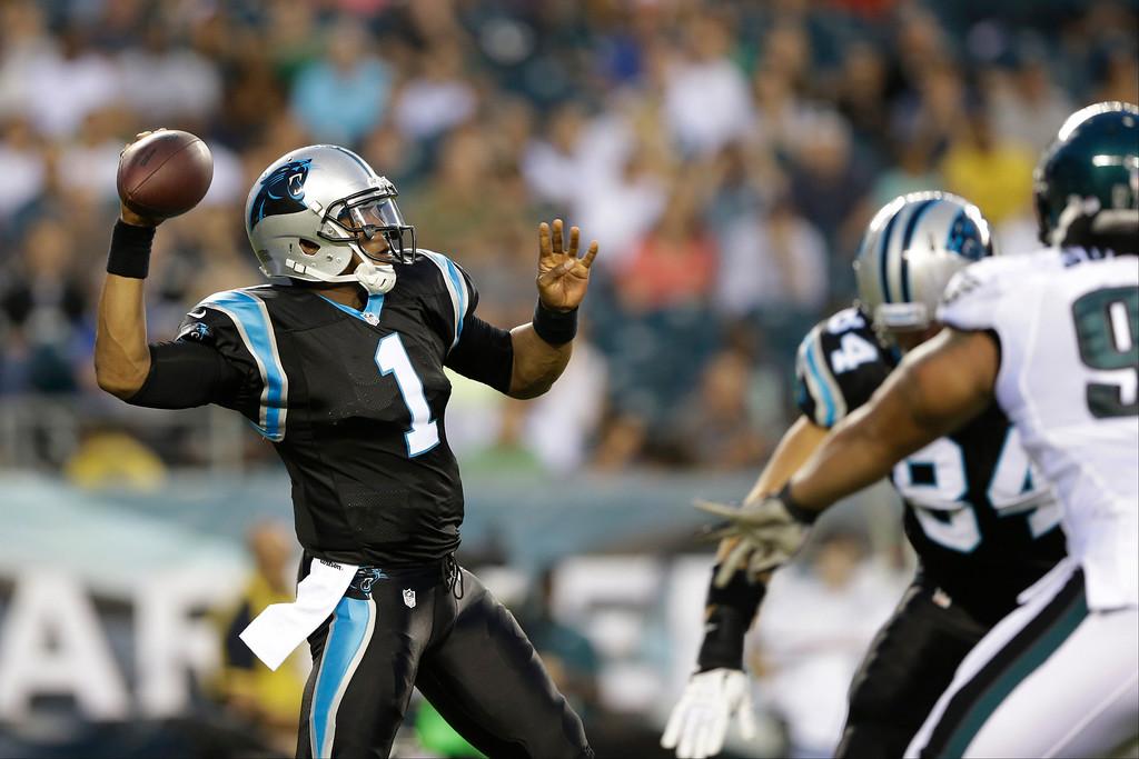 . Carolina Panthers quarterback Cam Newton passes during the first half of a preseason NFL football game against the Philadelphia Eagles, Thursday, Aug. 15, 2013, in Philadelphia. (AP Photo/Matt Rourke)