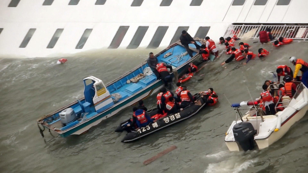 . In this image taken from video from Mokpo Coast Guard, passengers from a ferry sinking off South Korea\'s southern coast, are rescued by South Korean Coast guard in the water off the southern coast near Jindo, south of Seoul, Wednesday, April 16, 2014. Nearly 300 people were still missing Wednesday several hours after the ferry carrying 477, most of them high school students, sank in cold waters off South Korea\'s southern coast. (AP Photo/Yonhap) KOREA OUT