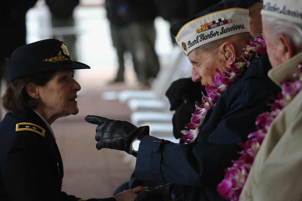 . Pearl Harbor survivor Aaron Chavin, 90, speaks with U.S. Army Major General Margaret Boor at a ceremony marking the 72nd anniversary of the attack on Pearl Harbor, Hawaii on December 7, 2013 in New York City. (Photo by John Moore/Getty Images)