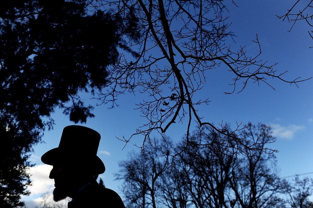 . Portraying U.S. President Abraham Lincoln, Tom Scott, talks to visitors during a commemoration of the 150th Anniversary of the Gettysburg Address at the Soldiers\' National Cemetery at Gettysburg National Military Park on November 19, 2013 in Gettysburg, Pennsylvania. (Photo by Patrick Smith/Getty Images)