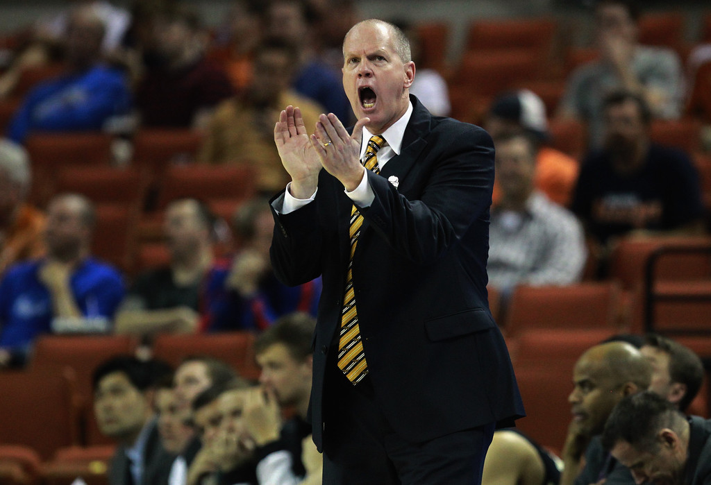 . AUSTIN, TX - MARCH 22:  Head coach Tad Boyle of the Colorado Buffaloes yells from the bench during the second round of the 2013 NCAA Men\'s Basketball Tournament at The Frank Erwin Center on March 22, 2013 in Austin, Texas.  (Photo by Ronald Martinez/Getty Images)