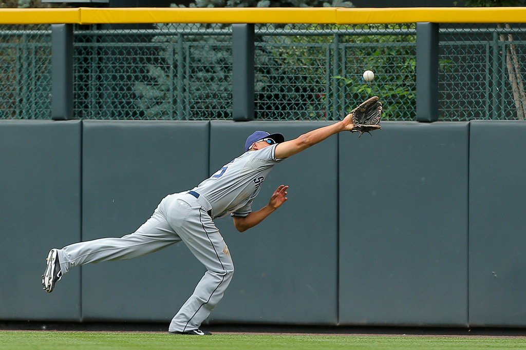 . DENVER, CO - JULY 9:  Center fielder Will Venable #25 of the San Diego Padres makes a diving catch for the first out of the fourth inning on a ball off the bat of Nolan Arenado (not pictured) of the Colorado Rockies at Coors Field on July 9, 2014 in Denver, Colorado. (Photo by Justin Edmonds/Getty Images)
