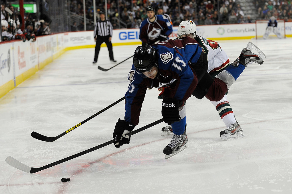 . PA Parenteau (15) of the Colorado Avalanche loses his footing while chasing the puck during the third period, Saturday, April 27, 2012 at Pepsi Center. Seth A. McConnell, The Denver Post