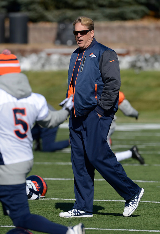 . Denver Broncos defensive coordinator, Jack Del Rio, walks the field during practice Friday morning, October 18, 2103.  (Photo By Andy Cross/The Denver Post)