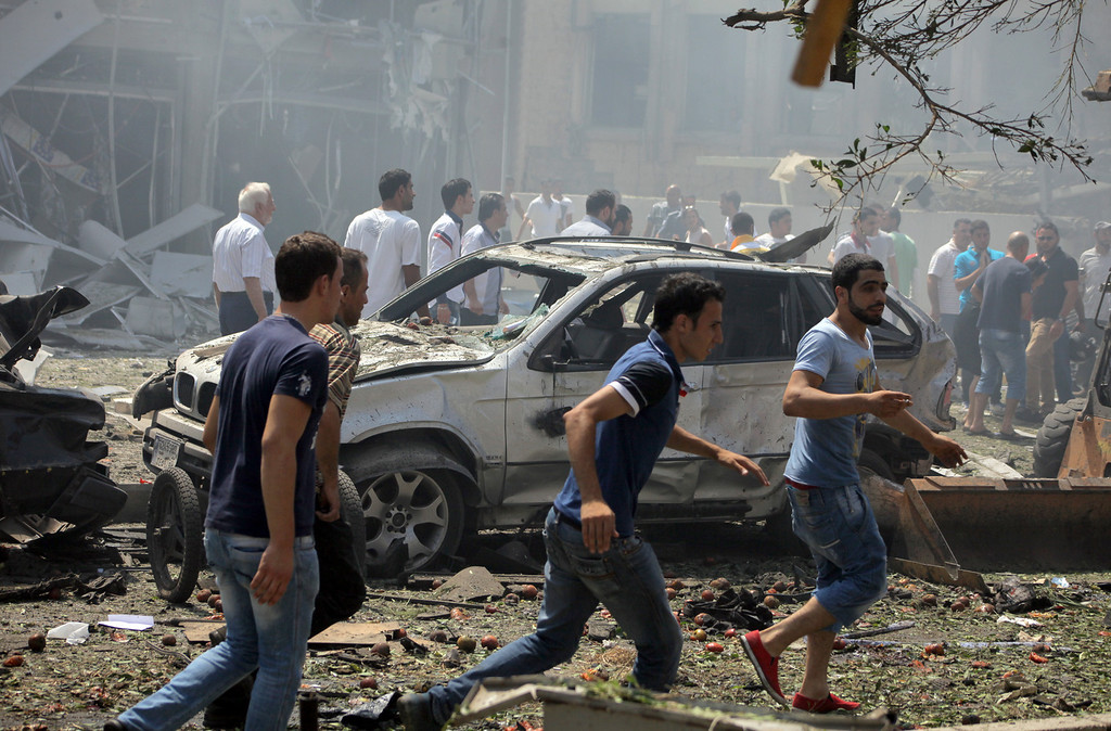 . Lebanese citizens gather outside al-Salam mosque, near the house of former Lebanese police chief Ashraf Rifi, at the site of a powerful explosion in the northern Lebanese city of Tripoli on August 23, 2013. AFP PHOTO / STRSTR/AFP/Getty Images
