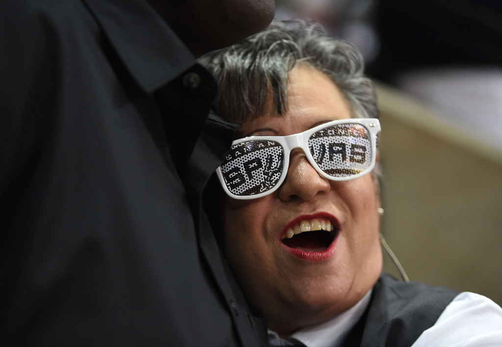 . AT&T Center usher and Spurs fan Norma Ramirez (R) is greeted by a fellow fan before the start of Game 5 of the NBA Finals between the Miami Heat and the San Antonio Spurs, June15, 2014 at the AT&T Center in San Antonio,Texas.  ROBYN BECK/AFP/Getty Images
