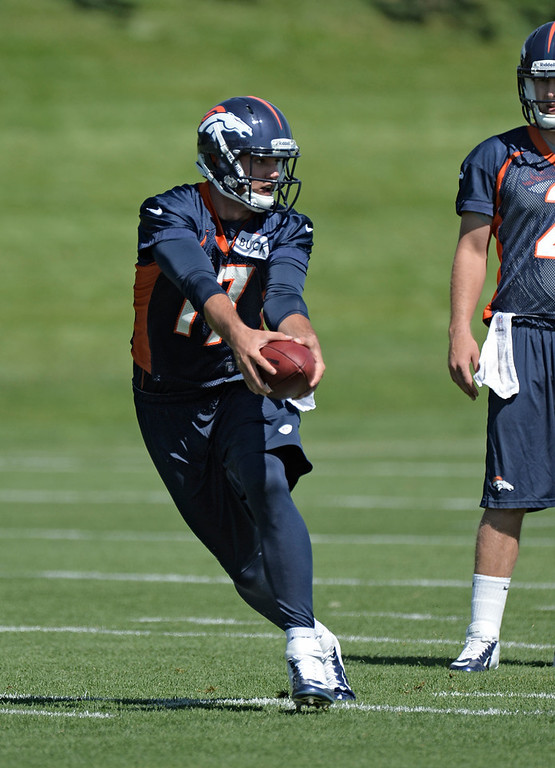 . Brock Osweiler (17 ) QB of the Denver Broncos drops back to pass during OTAs June 3, 2013 at Dove Valley. (Photo By John Leyba/The Denver Post)