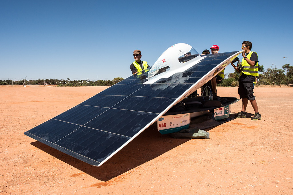 . The SER-2 of the Swiss solar energy race team charges its battery pack during a control stop in Coober Pedy, Australia, on Wednesday Oct. 9, 2013. The solar challenge race, lasting for seven days, will take 43 participants over 3,021 kilometers before ending on Sunday, Oct 13. (AP Photo/Geert Vanden Wijngaert)