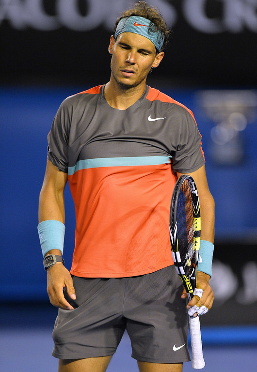 . Spain\'s Rafael Nadal reacts after a point against Switzerland\'s Stanislas Wawrinka during the men\'s singles final on day 14 of the 2014 Australian Open tennis tournament in Melbourne on January 26, 2014.    SAEED KHAN/AFP/Getty Images