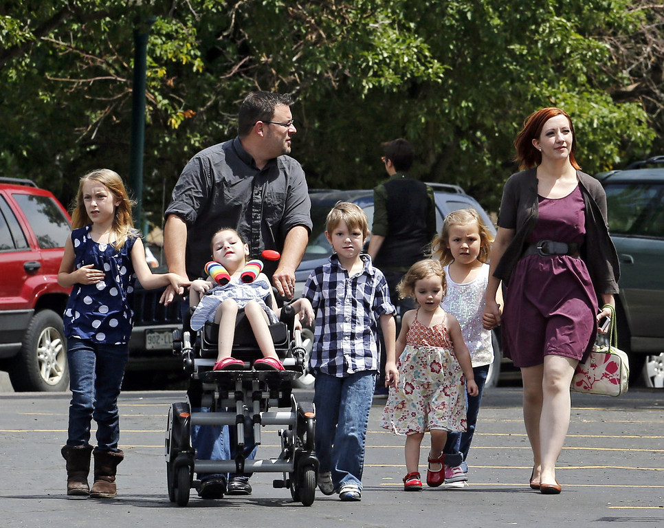 . Six-year-old transgender girl Coy Mathis, second from right, holds her mother Kathryn Mathis\'s hand as the family arrives for a news conference. The Colorado Civil Rights Division has ruled in favor of Coy Mathis, whose school had barred her from using the girls\' bathroom at her elementary school because she is transgender.  (AP Photo/Ed Andrieski)