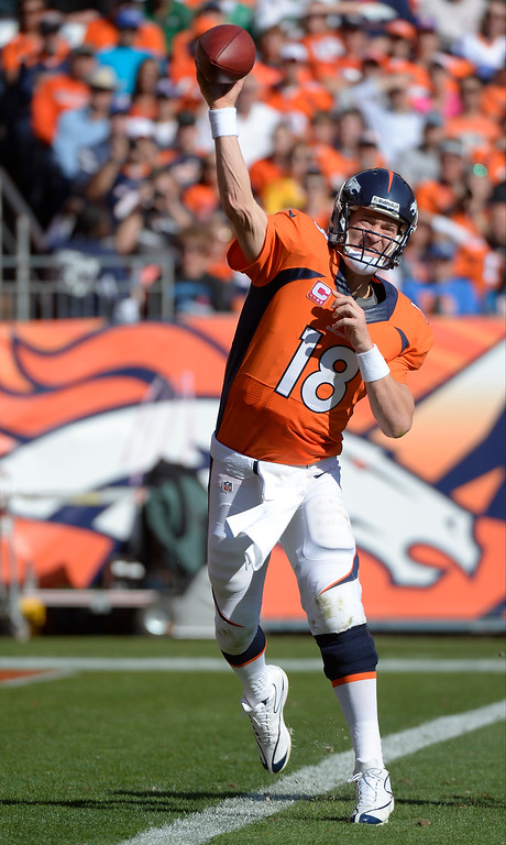. Denver Broncos quarterback Peyton Manning (18) makes a pass in the second quarter.  (Photo by John Leyba/The Denver Post)