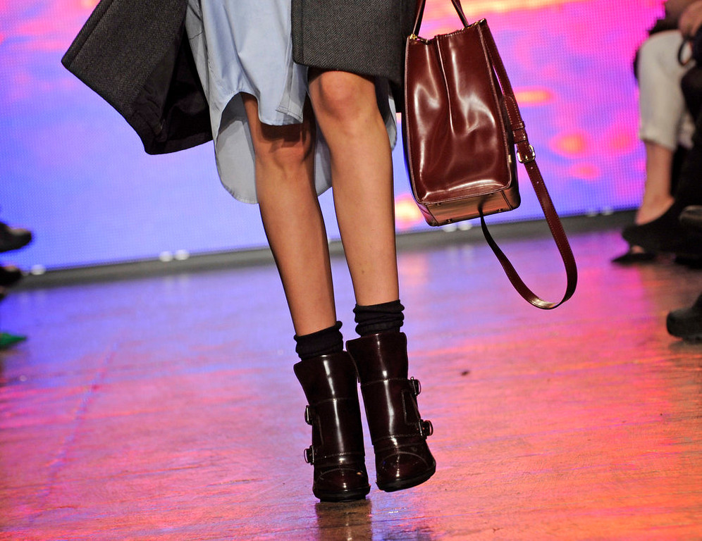 . The DKNY Fall 2013 collection is modeled during Fashion Week, Sunday, Feb. 10, 2013, in New York. (AP Photo/Louis Lanzano)