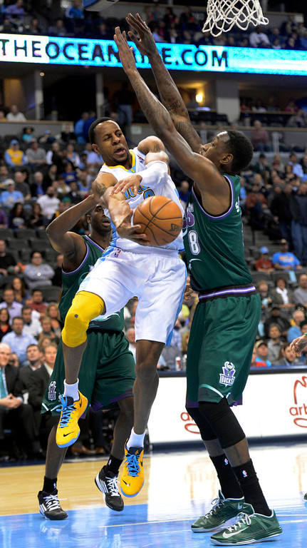 . DENVER, CO. - FEBRUARY 05: Andre Iguodala (9) of the Denver Nuggets pass off the ball past Larry Sanders (8) of the Milwaukee Bucks during the first quarter February 05, 2013 at Pepsi Center. The Denver Nuggets take on the Milwaukee Bucks in NBA action. (Photo By John Leyba/The Denver Post)