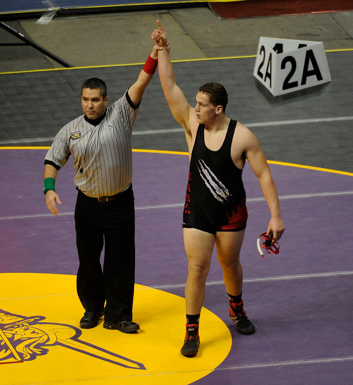 . DENVER, CO. - FEBRUARY 21: Paonia High School junior Tony Darling won a class 2A, 285-pound semifinal match, to advance to the finals Saturday night. Darling pinned Akron\'s Reed Christensen to advance. The CHSAA State Wrestling Tournament continued Friday, February 22, 2013 with quarterfinal and semifinal matches at the Pepsi Center in Denver. (Photo By Karl Gehring/The Denver Post)