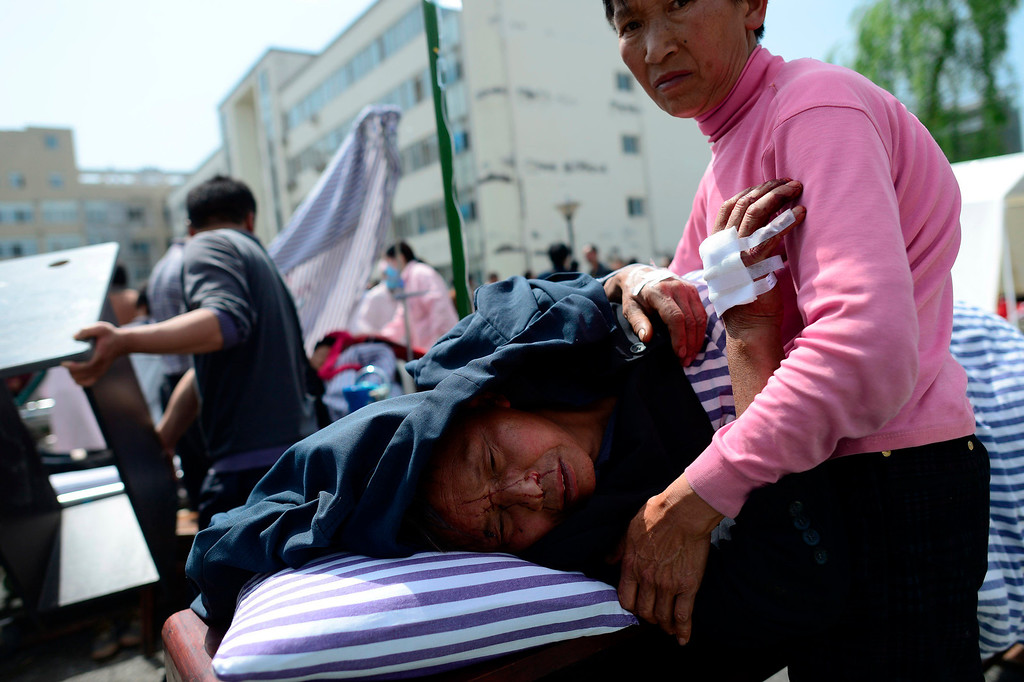. An injured man receives medical treatment at the People\'s Hospital after a strong earthquake hit Lushan county, Sichuan province, April 20, 2013, in this picture provided by Xinhua. The earthquake hit on Saturday morning, killing at least 102 people and injuring about 2,200.           REUTERS/Xinhua/Jiang Hongjing