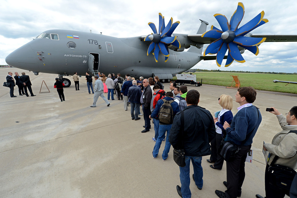 . Visitors look at an Antonov-70 plane during the International Aviation and Space Show MAKS-2013 on August 27, 2013 in Zhukovsky, outside Moscow. AFP PHOTO/KIRILL  KUDRYAVTSEV/AFP/Getty Images