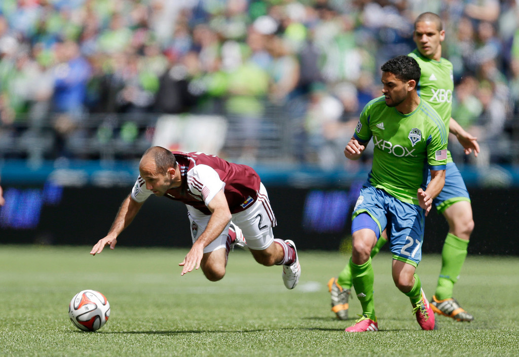 . Colorado Rapids\' Nick LaBrocca (2) goes down on a play involving Seattle Sounders\' Lamar Neagle, second from right, Saturday, April 26, 2014, in the first half of an MLS soccer match in Seattle. (AP Photo/Ted S. Warren)