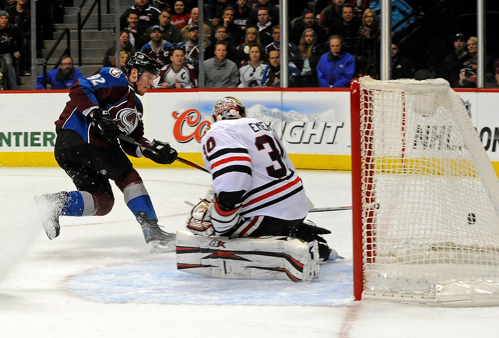 . Colorado Avalanche left wing Gabriel Landeskog (92), of Sweden ,scores a goal against Chicago Blackhawks goalie Ray Emery (30) during the first period of an NHL hockey game, Monday, March 18, 2013, in Denver. (AP Photo/Jack Dempsey)