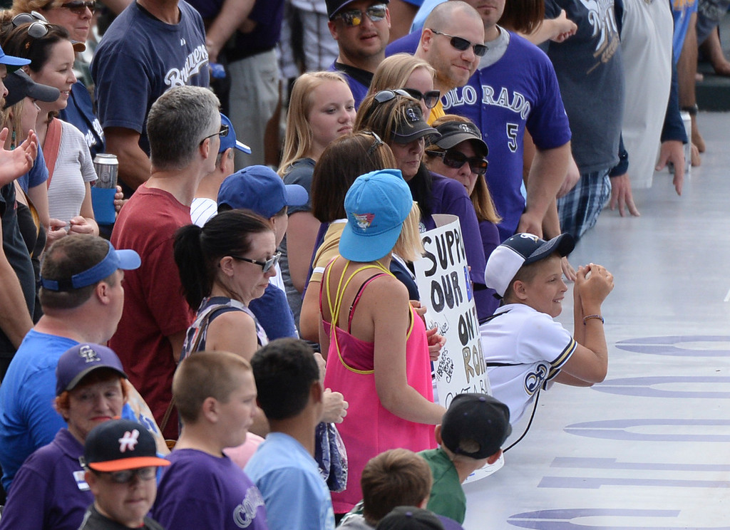 . DENVER, CO - JUNE 20: A young Brewers fan got a souvenir baseball after the game. The Milwaukee Brewers defeated the Colorado Rockies 9-4 at Coors Field Saturday afternoon, June 21, 2014. Photo by Karl Gehring/The Denver Post