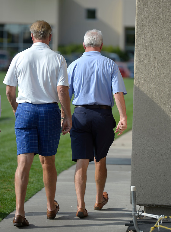 . Denver Broncos Executive V.P. of Football Operations John Elway and Denver Broncos head coach John Fox walk away after addressing the media August 20, 2013 at Dove Valley to comment on the six game suspension of linebacker Von Miller, handed down by the NFL for violating its drug policy. (Photo by John Leyba/The Denver Post)