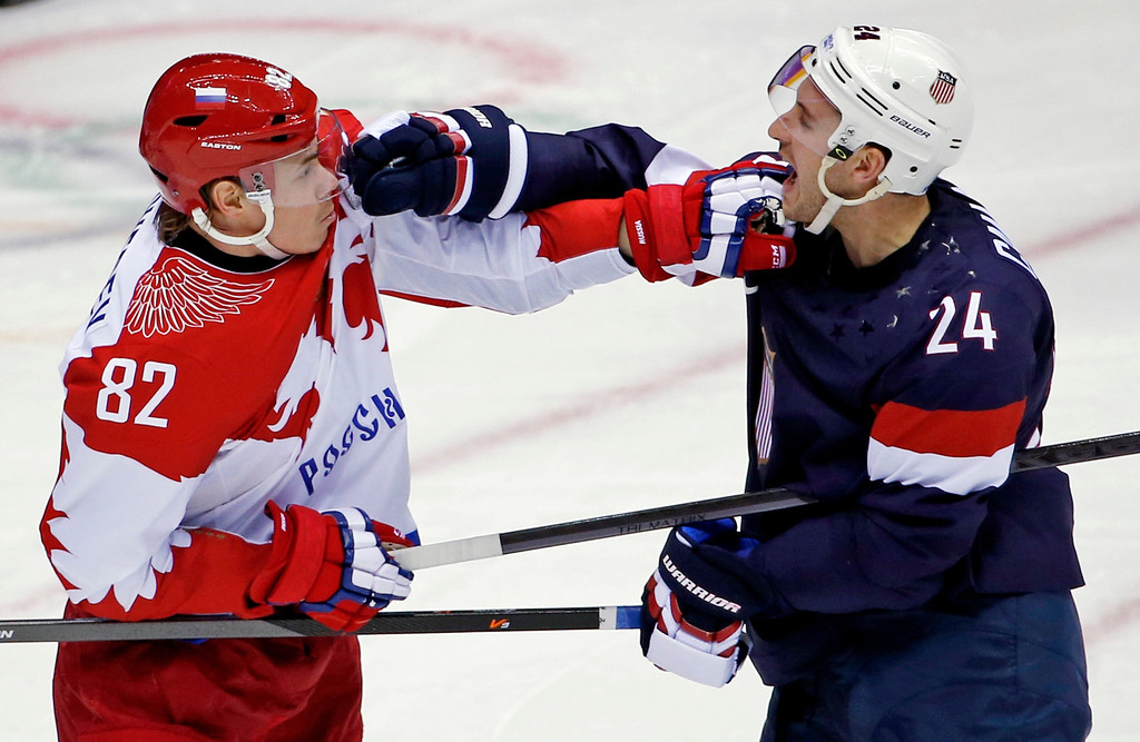 . Russia defenseman Yevgeni Medvedev and USA forward Ryan Callahan shove each other in the first period of a men\'s ice hockey game at the 2014 Winter Olympics, Saturday, Feb. 15, 2014, in Sochi, Russia. (AP Photo/Petr David Josek)