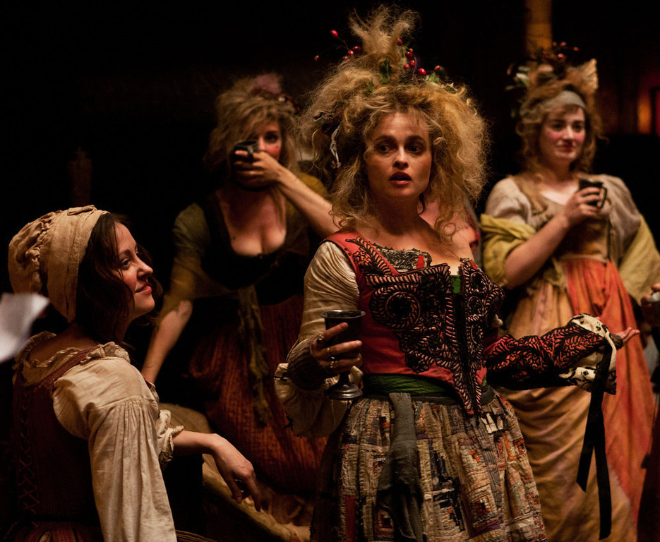 ". This undated publicity photo provided by Universal Pictures shows, center, Helena Bonham Carter as Madame Th�nardier in a scene from the film, ""Les Mis�rables.\"" (AP Photo/Universal Pictures/Laurie Sparham)"