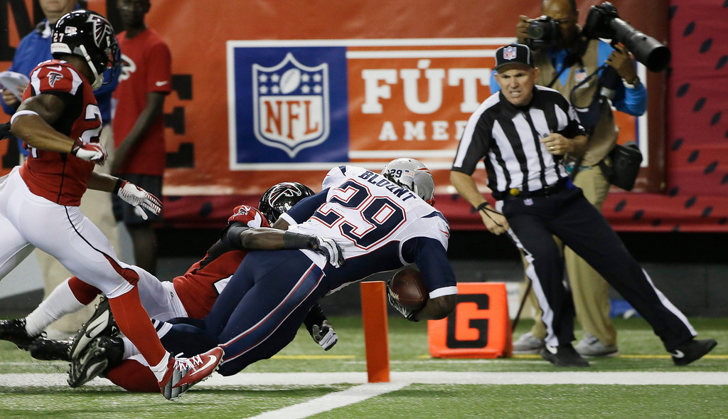 . New England Patriots running back LeGarrette Blount (29) runs into the end zone as Atlanta Falcons cornerback Desmond Trufant, (21) makes the tackle during the second half of an NFL football game, Sunday, Sept. 29, 2013, in Atlanta. (AP Photo/John Bazemore)
