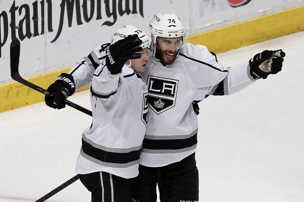 . Tyler Toffoli #73 of the Los Angeles Kings celebrates with teammate Dwight King #74 after scoring a goal against Corey Crawford #50 of the Chicago Blackhawks in the second period during Game Seven of the Western Conference Final in the 2014 Stanley Cup Playoffs at United Center on June 1, 2014 in Chicago, Illinois.  (Photo by Tasos Katopodis/Getty Images)