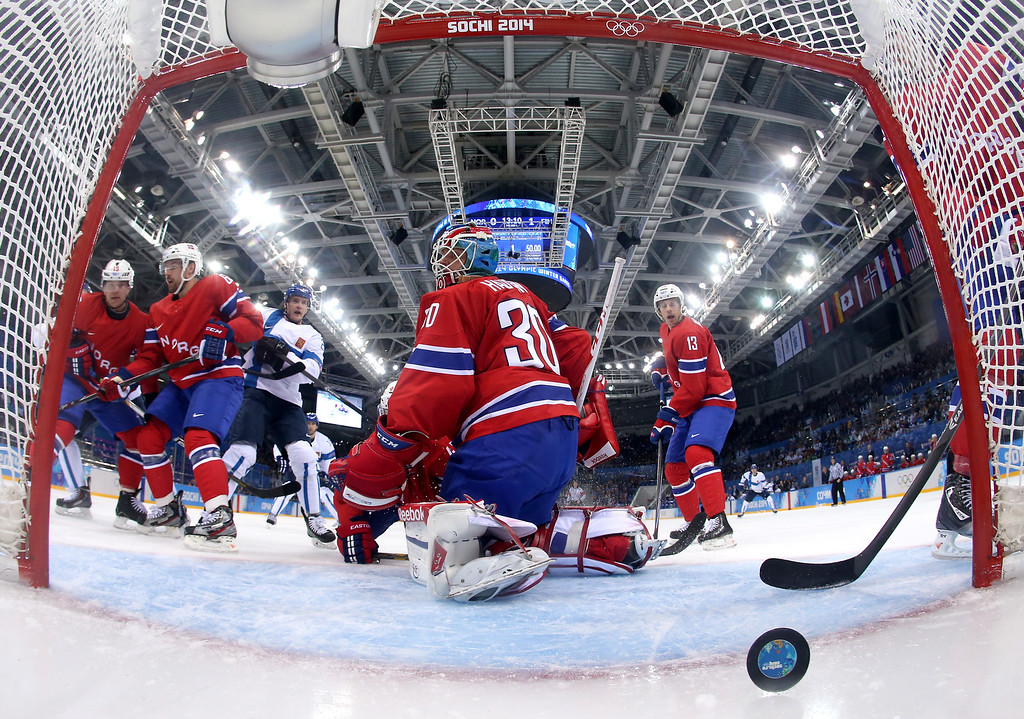 . Lars Haugen #30 of Norway gives up a goal to Lauri Korpikoski #28 of Finland in the first period during the Men\'s Ice Hockey Preliminary Round Group B game on day seven of the Sochi 2014 Winter Olympics at Shayba Arena on February 14, 2014 in Sochi, Russia.  (Photo by Martin Rose/Getty Images)