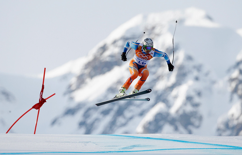 . Aksel Lund Svindal of Norway skis during the Alpine Skiing Men\'s Super-G on day 9 of the Sochi 2014 Winter Olympics at Rosa Khutor Alpine Center on February 16, 2014 in Sochi, Russia.  (Photo by Ezra Shaw/Getty Images)
