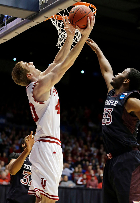 . Indiana forward Cody Zeller (40) shoots against Temple guard Scootie Randall (33) in the first half of a third-round game of the NCAA college basketball tournament, Sunday, March 24, 2013, in Dayton, Ohio. (AP Photo/Al Behrman)