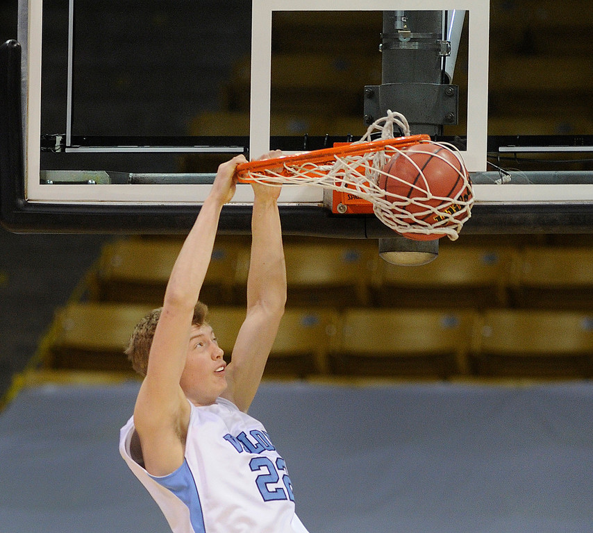 . BOULDER, CO. - MARCH 15: Eagles junior forward Chase Foster dunked the ball in the first half. The Valor Christian High School boy\'s basketball team stunned Broomfield 75-74 Friday night, March 15, 2013 at the Coors Events Center in Boulder.  (Photo By Karl Gehring/The Denver Post)
